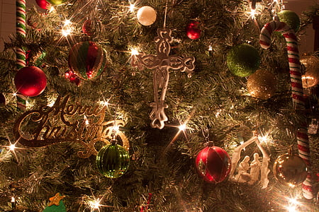 closeup photo of brown Christmas tree with lights and baubles