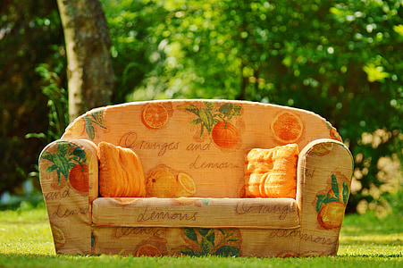 oranges and lemons printed fabric sofa on grass lawn