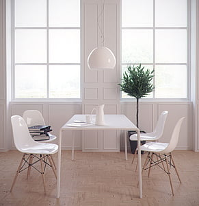 white table and four chairs near windows