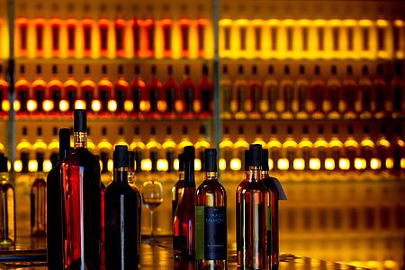 liquor bottles near bottles on rack
