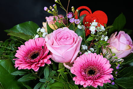 pink roses and gerbera daisy flowers