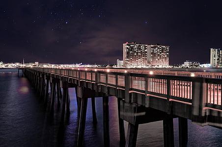 brown concrete bridge at night