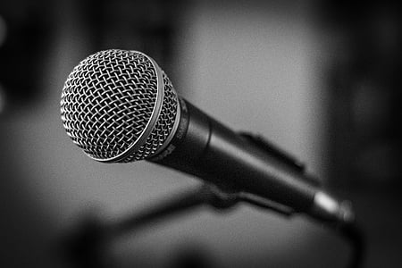 selective focus photography of black and grey microphone