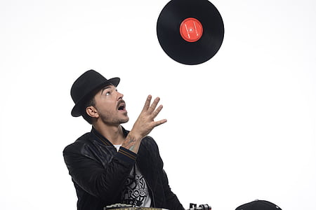 man throwing vinyl record