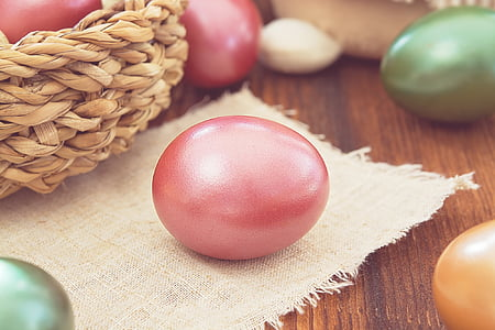 pink painted egg on burlap