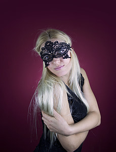 blonde haired woman in black floral lface mask