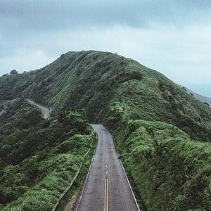 landscape of road beside mountain
