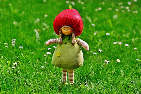 red and green plush toy on green grass field