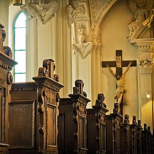 photo of church bench facing crucifix