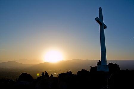 photo of white cross statue golden hour