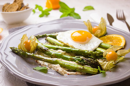 asparagus, egg, and physalis fruit