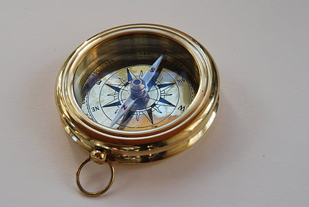round gold-colored compass