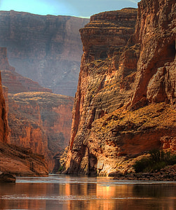 landscape photography of brown cliff and body fo water