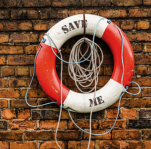 white and red Save Me-printed life buoy