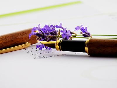 purple cluster flower beside brown fountain pen