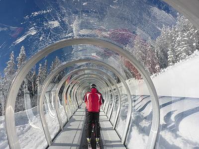 man in red jacket inside tunnel