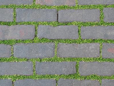 gray concrete block pathway