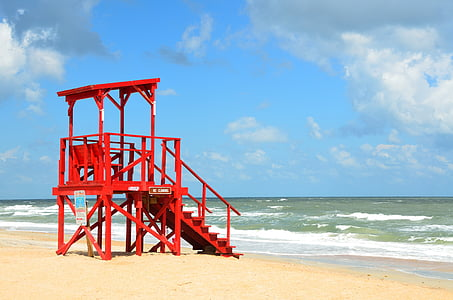 red Lifeguard station beside sea
