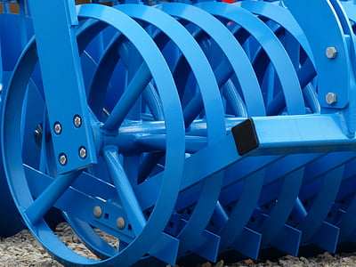 selective focus photography of blue cultivator blade