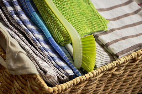 assorted-color textile on brown woven basket