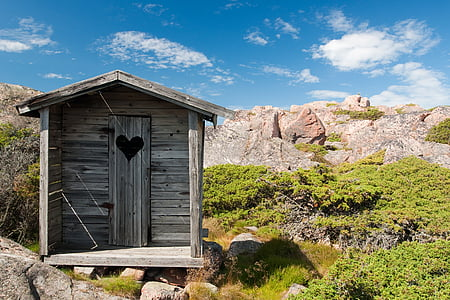 brown wooden shed on mountains