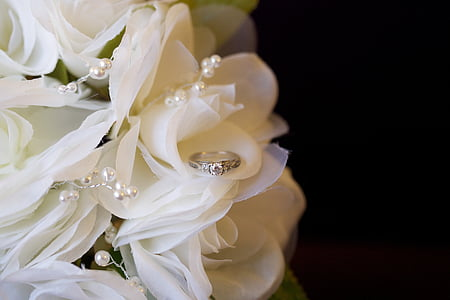 silver-colored ring on white bouquet