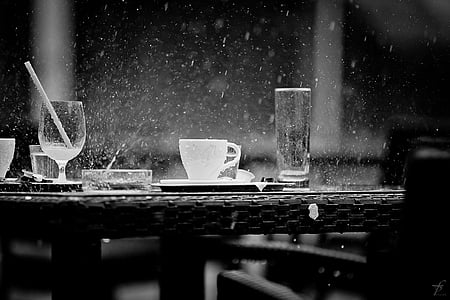 grayscale photo of glasses during rain