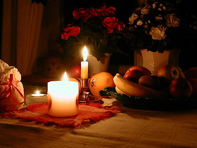 lighted candles beside fruits