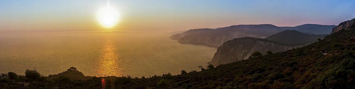 rearr view of blue ocean under sunrise