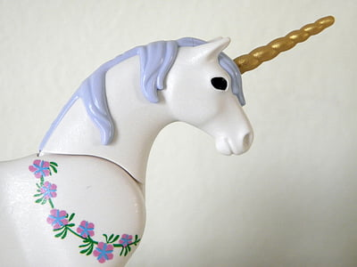 purple and hwite unicorn wall decor