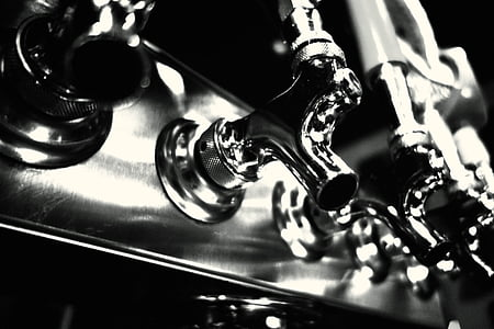 closeup photography of gray stainless steel faucets