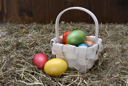 white wicker basket and easter eggs
