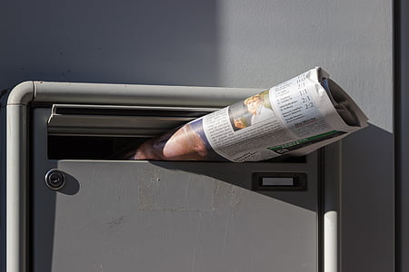 newspaper on mailbox