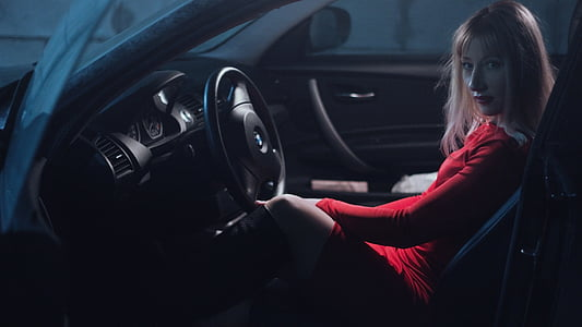 woman in red top inside a car