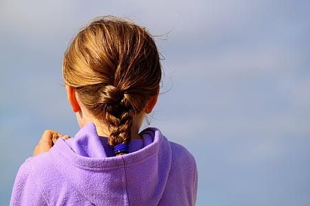 girl in purple hooded jacket