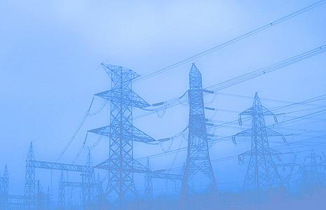 black steel electric posts during fog