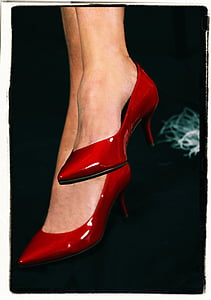 person wearing pair of red leather kitty heeled pointed-toe shoes