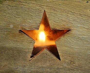 brown wooden plank with star figure