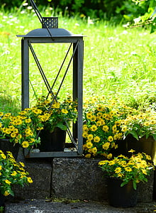 gray plant pot stand on garden