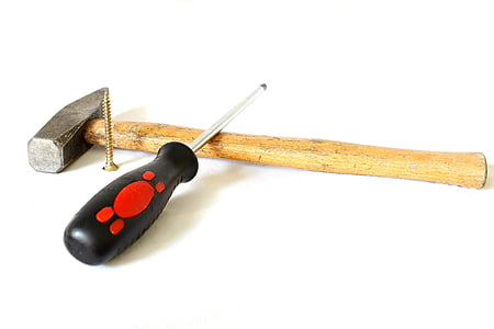 black screw driver and hammer
