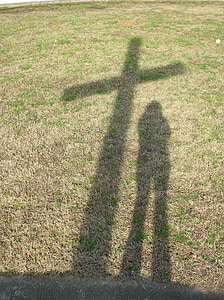 shadow of cross and person