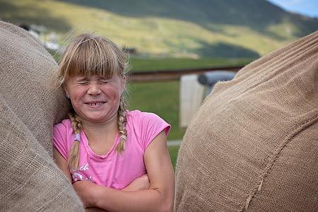 girl standing in between sacks