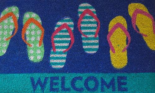 three pair of assorted-color flip-flop door mat