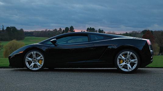 black Lamborghini Gallardo on road