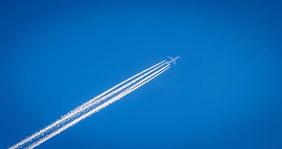 white plane with smoke trail