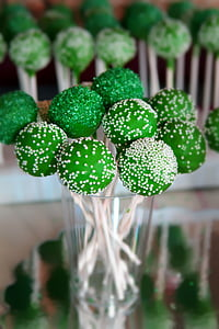selective focus photography of green lollipops