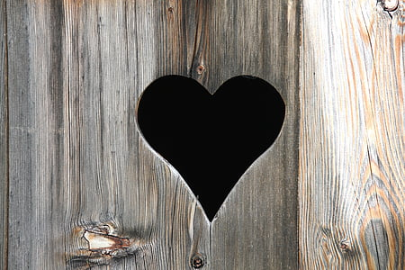 brown wooden board with heart design