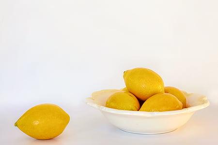 several lemons on white ceramic bowl