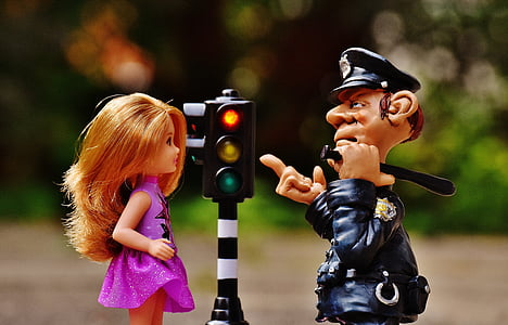 toy traffic light beside toy police man