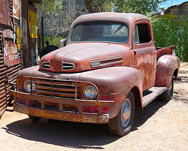 vintage brown Ford pickup truck park near galvanize sheet stall